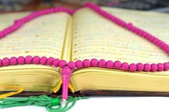 Holy Koran with a rosary praying beads