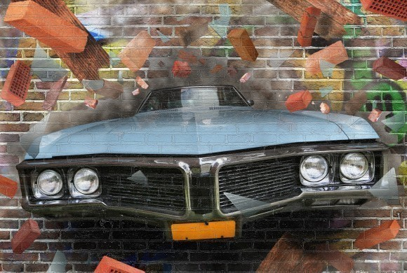 Graffiti car on a brick wall