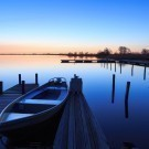 Tranquil, spring dawn in a small marina at a lake.
