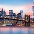 Manhattan skyline under a purple sunset
