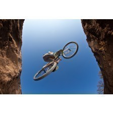 Boy going airborne with a dirt bike