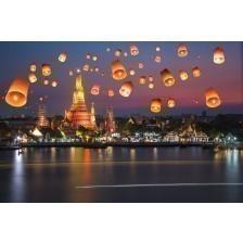 Flying paper lanterns at night