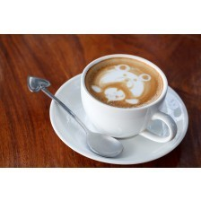 A cup of latte art coffee like face bear